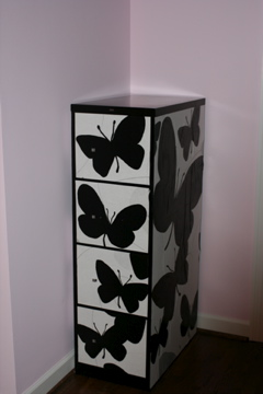 Pink's decoupaged black and white filing cabinet, via her old blog, Pink Mohair